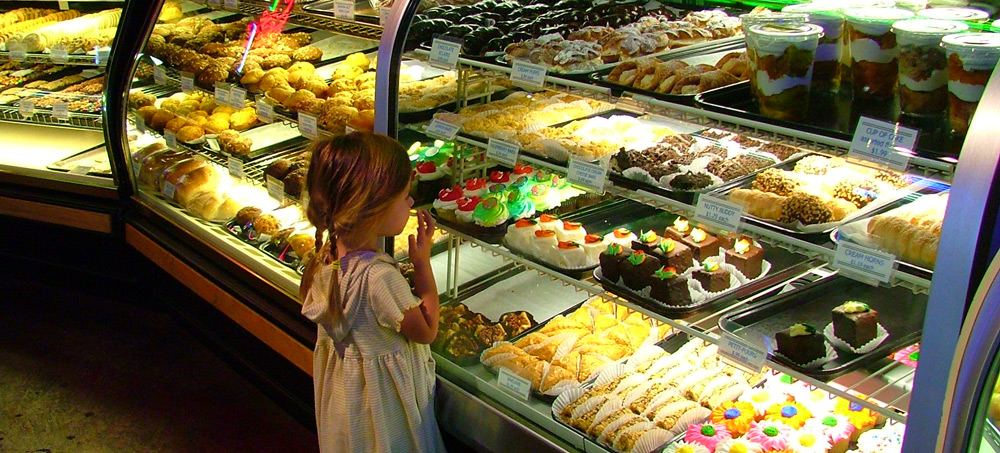 girl at cake shop